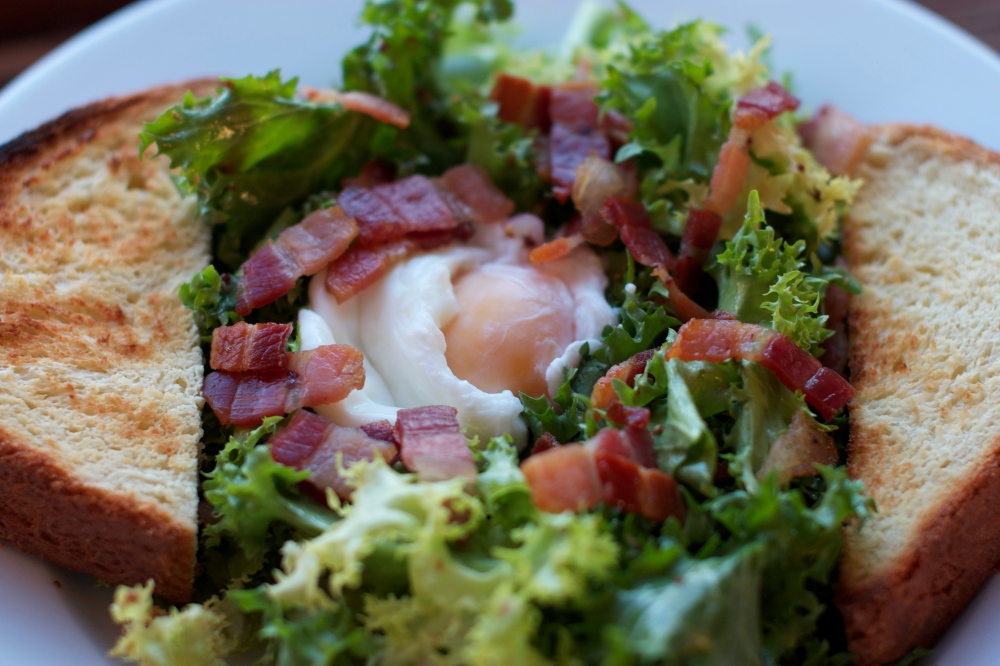 Frisée Salad with Warm Bacon Dressing and Poached Eggs