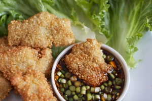 Crunchy Quinoa-dipped Fried Chicken Fingers with a spicy soy sauce based dip