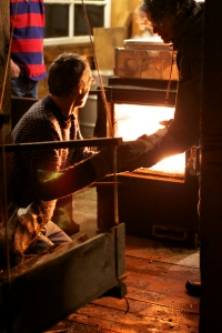 Loading Wood to Boil Sap